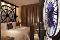 Above:   Have a grand  time sleeping beneath a replica of the Musée  d'Orsay clock at the Hotel Design Secret de Paris in Paris.Courtesy Hotel Design Secret de Paris - Hotel Design Secret de Paris