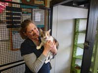 Stephanie Hall, director of operations for Second Chance SPCA in Plano, shares a moment earlier this year with Princess Peach, one animals the shelter has saved over the years.
