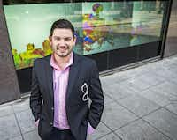 """""""We bring the best of online marketing to physical brick-and-mortar,"""" said Daniel Black, founder and CEO of Glass Media. Behind him is his newest digital window display on the ground floor of the Adolphus Tower.( Ashley Landis  -  Staff Photographer )"""