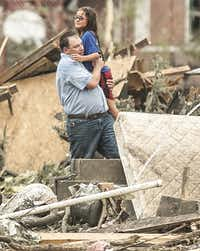 A man holds a girl after she was pulled from the basement of her destroyed home in Pilger, Neb., Monday, June 16, 2014. A hospital spokeswoman says at least one person is dead and at least 16 more are in critical condition after two massive tornadoes swept through northeast Nebraska. (AP Photo/Mark 'Storm' Farnik)(Mark 'Storm' Farnik - AP)