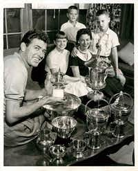 The Shelby family in the 1960s included (from left) Carroll Shelby, daughter Sharon, middle son Pat, first wife Jean and oldest son Michael.