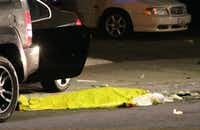 "In this image provided by KEYT-TV, a body is covered on the ground after a mass shooting near the campus of the University of Santa Barbara in Isla Vista, Calif., Friday, May 23, 2014.  A drive-by shooter went on a ""mass murder"" rampage near the Santa Barbara university campus that left seven people dead, including the attacker, and seven others wounded, authorities said Saturday. (AP Photo/KEYT, John Palminteri)(John Palminteri - AP)"