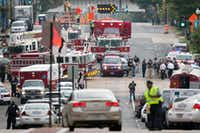 Emergency personnel respond to a reported shooting at the Washington Navy Yard, Monday, Sept. 16, 2013 in Washington. Police and federal agents from multiple law enforcement agencies responded to the scene. Ambulances were parked outside, streets in the area were closed and departures from Reagan National Airport were temporarily halted for security reasons.   (AP Photo/Manuel Balce Ceneta)Manuel Balce Ceneta - AP