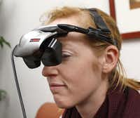 Research assistant Katie Bridges demonstrates virtual reality goggles used for assertiveness training in SMU's bystander program.( Rose Baca  -  Staff Photographer )