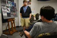 Guildhall students Austin Martin (center frame) and Nick Slay discuss their video game, Bionic League Tournament.(Photo by ROSE BACA - neighborsgo staff photographer)