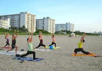 Stretch surrounded by beauty at sunrise and sunset sessions offered by 3rd Street Beach Yoga in South Beach.(Robin Soslow - Robin Soslow)