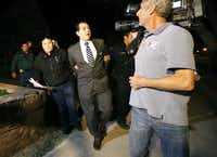 In February, Crystal City Mayor Ricardo Lopez was taken away from city hall by police after allegedly disrupting a City Council meeting while fighting a recall effort that began before his indictment this month in a public corruption investigation that has ensnarled him and most of the council.(Kin Man Hui - AP)