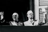 General Francisco Franco  and then-Prince Juan Carlos saluting the crowd in Madrid in October 1975.- - AFP/Getty Images