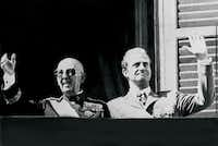 General Francisco Franco  and then-Prince Juan Carlos saluting the crowd in Madrid in October 1975.(- - AFP/Getty Images)