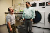 Joaquin Blano  (right), vice president of community and volunteer affairs at the SPCA, visits with Michael Grimes, a special education student from the Notre Dame School of Dallas at the SPCA of Texas in Dallas.(ROSE BACA - neighborsgo staff photographer)