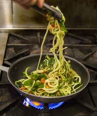 Chef Danyele McPherson makes a zucchini pasta bowl from spiraled zucchini on Thursday, March 31, 2016 at Remedy restaurant in Dallas. (Ashley Landis/The Dallas Morning News)(Ashley Landis - Staff Photographer)