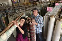 Ewa Powell (left) and James Powell (right), owners of Modern Fabrics in Charlotte, N.C., love what they do with recycling leftover industrial fabric to sell to do-it-yourselfers. The business has been quietly growing for the past five years, offering designer fabrics rescued from cutting room floors of area furniture companies.
