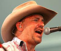 Kevin Costner leads his band Modern West during the Stagecoach Country Music Festival in 2009.