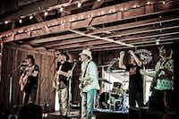 Stonehoney, an Austin band, plays in the Luckenbach Dance Hall in April during the Music Road records Showcase.