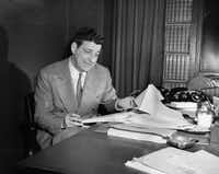 Book publisher Roger Straus is shown at his desk in his office in New York City, March 10, 1956. Straus, who, with John Farrar, founded Farrar, Straus & Co. ten years ago. Roger W. Straus Jr. died on May 25, 2004. He was 87.
