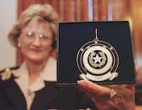 ORG XMIT: AT101 Nelda Laney displays the 1997 Texas Capitol ornament going on sale during an announcement Friday, Sept. 26, 1997, in Austin, Texas. The second in a series of Christmas ornaments featuring symbols of Texas, this year's ornament is a copy of the State Seal. Mrs. Laney, wife of Texas House Speaker Pete Laney, is project chairwoman of the sale, the proceeds of which help fund educational programming and continued preservation of the Capitol.  (AP Photo/Harry Cabluck)HARRY CABLUCK - AP