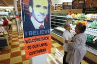Market Basket employees Cristhian Romero, of Chelsea, Mass., second from right, and Tracie Parker, of Lynn, Mass., right, embrace near a likeness of Arthur T. Demoulas, top, at a Market Basket supermarket location, Thursday, Aug. 28, 2014, in Chelsea. A six-week standoff between thousands of employees of the New England supermarket chain and management has ended with the news that beloved former CEO Demoulas is back in control after buying the entire company. (AP Photo/Steven Senne)Steven Senne - AP