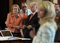 State Senators Sylvia Garcia, Jose Rodriguez, and Kirk Watson listen as Wendy Davis filibusters during the final day of the legislative special session, as the Senate considers an abortion bills on Tuesday, June 25, 2013. (Louis DeLuca/Dallas Morning News)