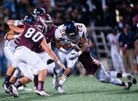 Sachse running back Devine Ozigbo carries the ball in Sachse's 57-31 win over Rowlett on Oct. 11.