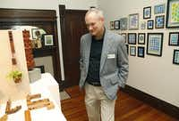 Michael Coleman, board president for the ArtCentre of Plano, checks out an exhibit on display at its location at 901 18th St. in Plano.( Photo by Stewart F. House   -  special contributor )