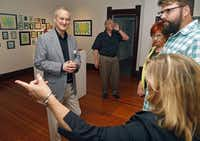 Coleman meets with artists whose work is being exhibited at a reception at 901 18th St. It hosts between nine and 11 exhibits a year and sees more than 150,000 visitors.( Photo by Stewart F. House   -  special contributor )