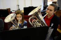 Band students Ellie Howard (left), 9, and Rebecca Hood 239  play their instruments at the Salvation Army's Dallas Temple Community Center's free weekly practice in Dallas.(Rose Baca - neighborsgo staff photographer)
