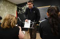 Josh Knapp, a volunteer and Irving school teacher, guides the beginning band class at the community center.(Rose Baca - neighborsgo staff photographer)