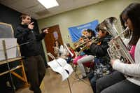 Josh Knapp, a volunteer and Irving school teacher, guides the beginning band class at the Salvation Army's Dallas Temple Community Center near Love Field.(Rose Baca - neighborsgo staff photographer)