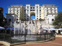 The Eilan feels European, with its plaza, fountains and Sunday market. Corner rooms offer views of its swimming pools and the surrounding Hill Country.June Naylor  -  Special Contributor