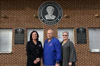 Girls basketball coach Cathy Self-Morgan; Steve Martin, Sandra Meadows Classic organizer; and his wife, Janice Savage-Martin, tournament volunteer and former Duncanville basketball player, stand next to a plaque honoring the legendary coach Sandra Meadows.ROSE BACA