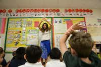 Kindergartner dual-language teacher Raquel Rodríguez sings a song in Spanish during class at Alex Sanger Elementary. The school offers a dual-language program for students, and this year it added a Spanish kindergarten immersion class.Rose Baca - neighborsgo staff photographer