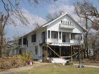 Before: The Schaeffer House, built in the late 19th century in Pass Christian, Miss., lost its front wall to Hurricane Katrina's storm surge.