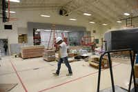 <TypographyTag16>Construction workers</TypographyTag16> renovate the gym at Hedgcoxe Elementary School in Plano. Hedgcoxe is just one of a number of school construction projects, totaling $57.1 million, now in progress to address maintenance needs and changes in classroom sizes at Plano ISD this summer.(Rose Baca - neighborsgo staff photographer)