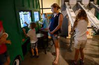 Lauren Del Busto watches her son Marcus play with a display at the recycling exhibit at the Frisco Sci-Tech Discovery Center, a childrenÕs science and technology museum. The city of Frisco recently approved approximately $450,000 worth of renovations to the center as well as its neighbor across the hall, the Frisco Discovery center, home to the Black Box Theatre.