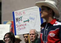 "<p></p><p><span style=""font-size: 1em; background-color: transparent;"">A 2013 file photo of pro-science supporters rallying prior to a State Board of Education public hearing on proposed science textbooks in Austin, Texas. </span><span style=""background-color: transparent; font-size: 1em;"">(Eric Gay/The Associated Press)</span></p><p></p>"