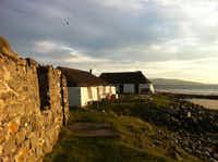 The Gatliff Trust-run hostel on the island of Berneray is steps away from the sea and crumbling farmhouses. A marked trail nearby allows an easy day hike around the tiny island.( Cara Anna  -  AP )