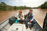 """Hunter and Sarah Anderson and their two dogs were rescued Wednesday by Marine Police from their home in Baldwin County, Ala., after rains caused the Fish River to crest to historic levels. """"The river floods, it's just never this bad,"""" Hunter Anderson said.Sharon Steinmann  -  The Associated Press"""