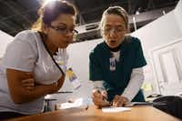 Catherine Henon  (right), registered nurse and CNA instructor at El Centro College, goes over a skills test result with Nayeli Garza Rodriguez.ROSE BACA