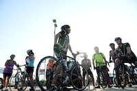 Joel Hoback, founding member of the Shawnee Trail Cycling Club, talks to cyclists before the Thursday Night Rider in Frisco.(ROSE BACA - neighborsgo staff photographer)