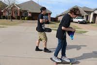 Ethan Raaum, 13, and Zack Rodkey, 14, skateboard down the street in their Frisco neighborhood.Photos by Rose Baca  - neighborsgo staff photographer