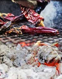 "Tim Byres' cookbook ""Smoke: New Firewood Cooking"" is a handy how-to on cooking with wood fire, including roasting chiles."