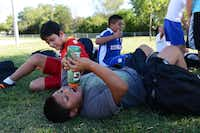Michael Contreras takes a water break during the soccer team's practice at Strickland Intermediate School in Farmers Branch. Aguirre created the team to get students involved in a school activity that would improve their grades and help with behavioral issues.