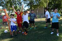 Fourth and fifth grade soccer players react after a teammate scores a goal during the team's practice at Strickland Intermediate School in Farmers Branch. Aguirre created the team to get students involved in a school activity that would improve their grades and help with behavioral issues.