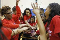The Duncanville Sparklers including (from left) Starr Scott, Tamara Johnson, Lilibeth Ramirez, Maleah Jones, Brianna Durham, Damian Jordan, Lauryn Duncan and Ke'Anda Delley, put their hands together during a practice session at Duncanville High School. The Sparklers, a cheer squad for students with disabilities, have been invited to perform at the Special Olympic World Games in Los Angeles this summer.( Staff photo by Jim Tuttle  -  DMN )