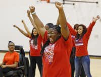 Lauryn Duncan (center) and her fellow Duncanville Sparklers demonstrate a cheer at Duncanville High School. The Sparklers, a cheer squad for students with disabilities, have been invited to perform at the Special Olympic World Games in Los Angeles this summer.( Staff photos by Jim Tuttle  - Staff Photographer)