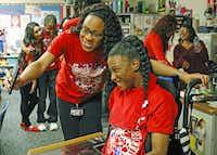 Helper Maleah Jones (left) and Sparkler Brianna Durham take a photo together.( Staff photo by Jim Tuttle  -  DMN )