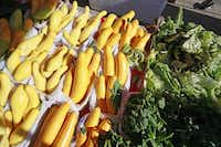Squash and greens on sale from Baugh Farms in Canton at the St. Michael's Farmers MarketBen Torres  -  Special Contributor