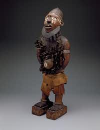 This  standing power figure   from the DMA collection is now showing at the Metropolitan Museum of Art.(Dallas Museum of Art)