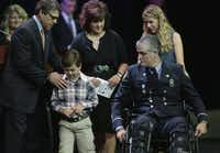 Gov. Rick Perry greets the family of firefighter Robert Yarbrough, who was injured in a Houston fire that killed four of  his colleagues.