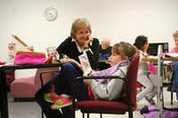 Volunteer Cheryl Alexander listens to Lauren Smith, 6, read aloud.Photo by RUTH HAESEMEYER